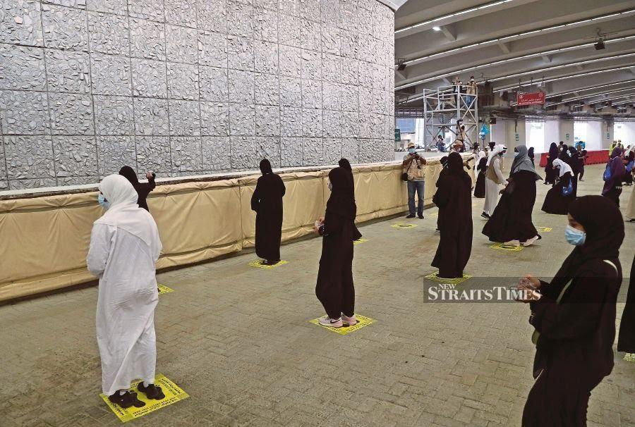 Pilgrims stone Satan in last major rite of scaled-back haj